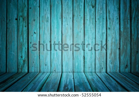 dark room interior with blue painted wooden walls and floor - stock photo