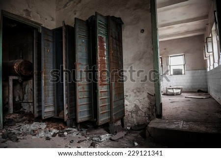 Dark room with steel lockers inside angle shot - stock photo