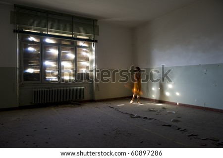 Dark room with woman dancing.