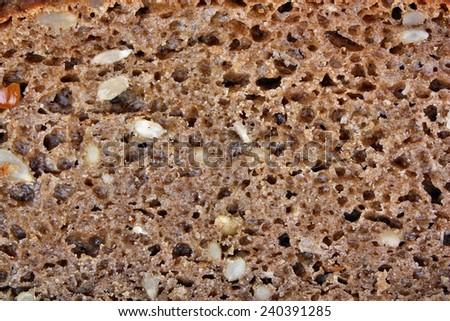 Dark rye bread with sunflower seeds - stock photo