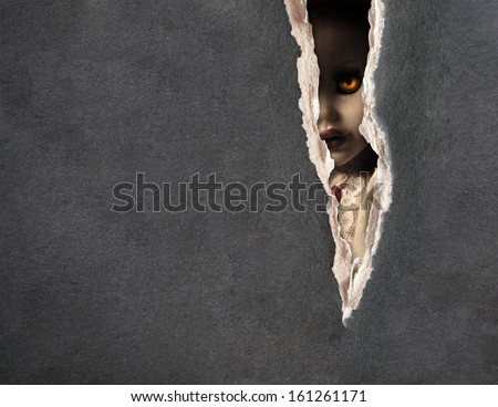 Dark series - a look from darkness. Spooky doll - stock photo