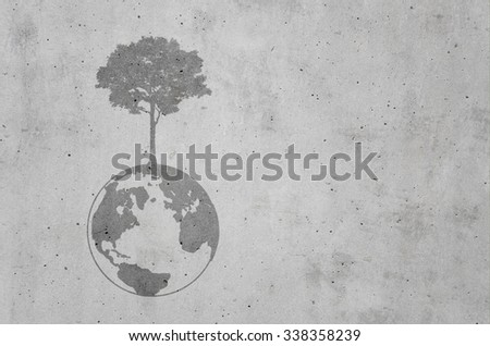 dark shadow of growing tree plant on earth sphere map graphic, on light gray concrete background. ecology concept - stock photo