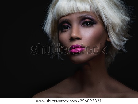 dark skin or mulatto beauty portrait of pretty woman on black - stock photo