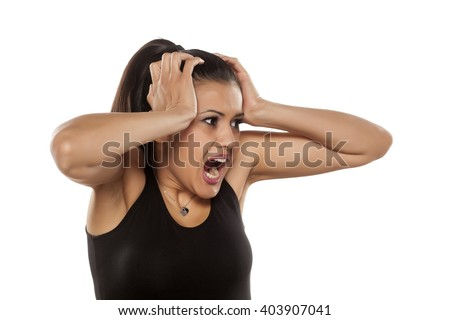 dark skinned beautiful young woman is afraid of something - stock photo