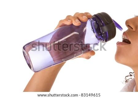 Dark skinned ethnic female holding bottle of water - stock photo