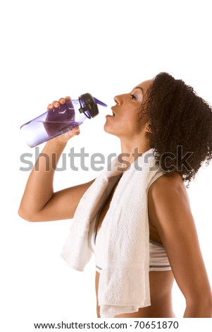 Dark skinned female in sporty outfit holding bottle of water - stock photo