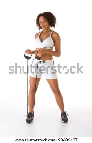 Dark skinned female stretching using rubber band - stock photo