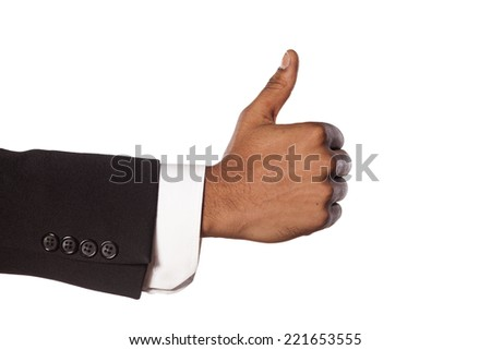 dark skinned hand in suit showing thumb up - stock photo