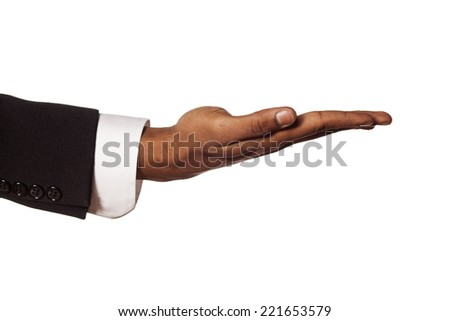 dark skinned hand in suit with the palm up