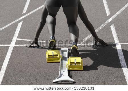 Dark-skinned sprinter in start position prepares for the start - stock photo