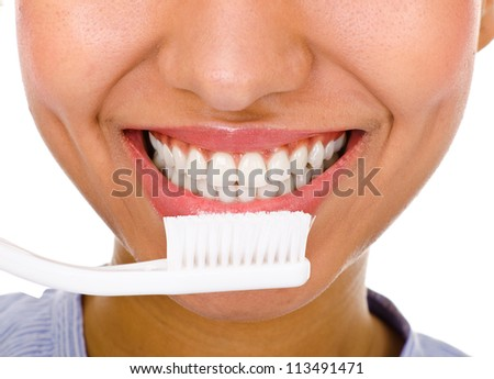 dark-skinned woman holding a toothbrush. the right choice in dental hygiene