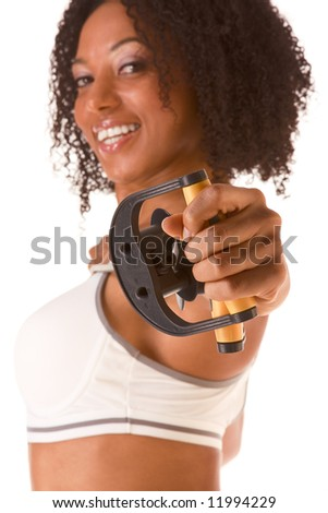 Dark skinned woman stretching using rubber band (selective focus on hand) - stock photo