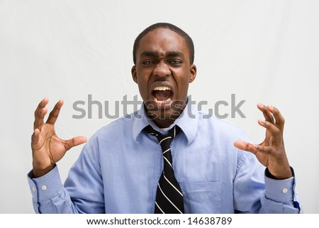 Dark skinned young business professional screaming, MBA student, or such, isolated on white