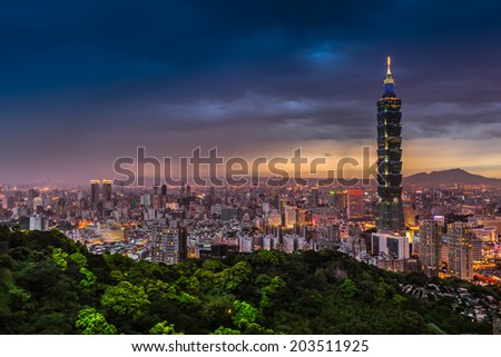 Dark sky at an spring night illuminated city lighting and wide cityscape of Taipei, Taiwan/Taipei City View at Night - stock photo