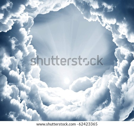 dark sky with sun and beautiful clouds - stock photo
