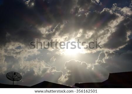 Dark sky with sun on rainy day - stock photo