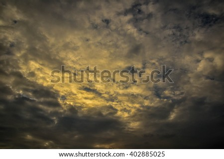 Dark sky with yellow light sun photo - stock photo
