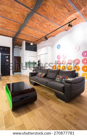 Dark sofa and color cushions in contemporary interior - stock photo