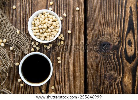 Dark Soy Sauce (close-up shot) on Bamboo background - stock photo