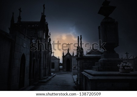 Dark spooky Halloween european graveyard with clouds - stock photo