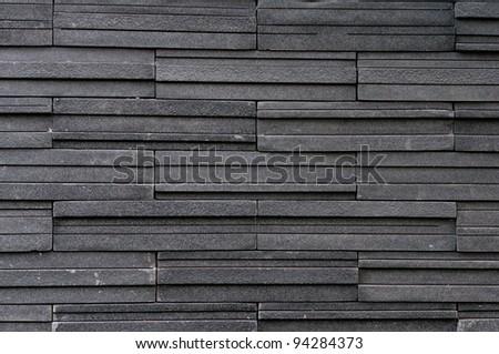 Dark stone tile texture brick wall surfaced - stock photo