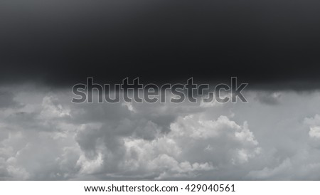 Dark storm cloud layer with cloudscape layer - stock photo