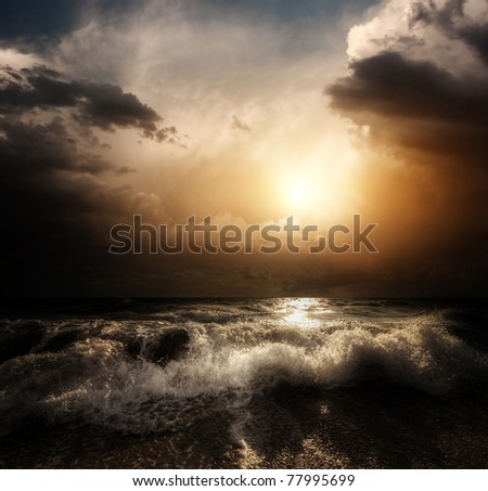Dark storm clouds and huge waves on a sea - stock photo