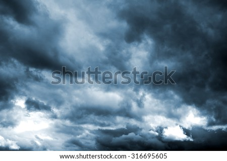 Dark storm clouds before rain. Natural background. - stock photo