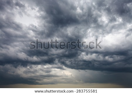 dark storm clouds in the evening spring sky - stock photo