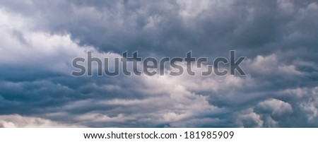 Dark storm clouds. Menacing dark sky stress lead with dark clouds - stock photo