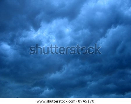 dark storm clouds texture with large-area contrast - stock photo