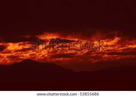 Dark storm clouds with red light. Great impression of distance, danger, emotions. Makes a nice background - stock photo