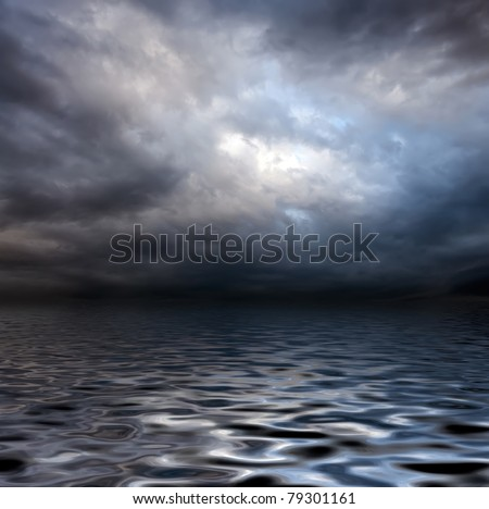 dark storm sky over water surface with artistic shadows added - stock photo