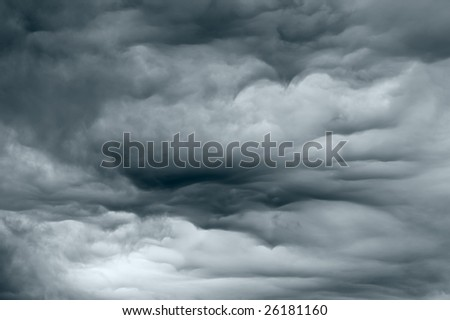Dark stormy clouds forming before the rain - stock photo