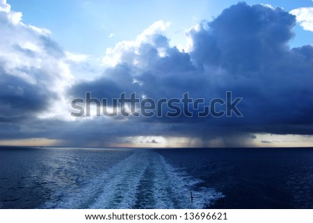 Dark stormy clouds. View from car ferry - stock photo