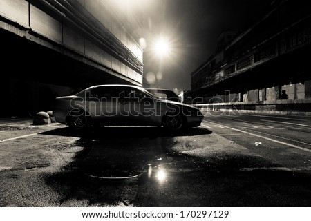 Dark Street at Night in Black and White - stock photo