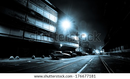 Dark Street at Night in Black and White. LIGHTING FILM NOIR STYLE - stock photo