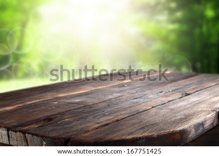 dark table in spring green garden  - stock photo