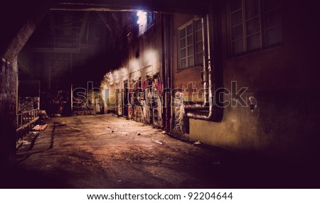Dark vintage  back yard with graffiti - stock photo