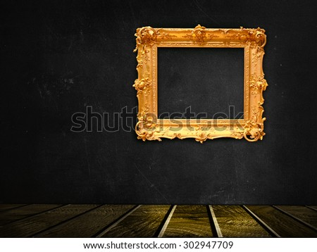 dark vintage black room with wooden floor and golden frame hanging on the wall