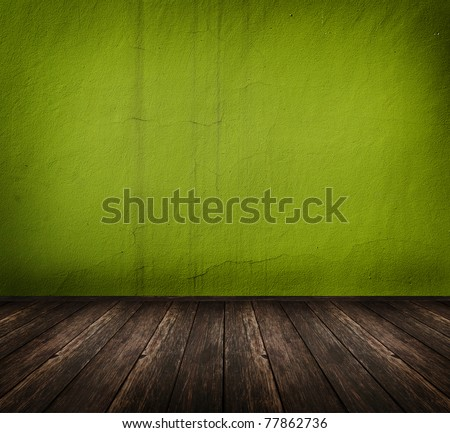 dark vintage green room with wooden floor and artistic shadows added - stock photo