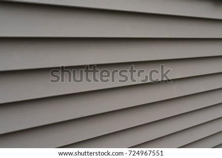 beige vinyl siding vinyl siding texture background residential neighborhood stock