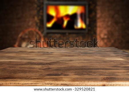 dark wall with black fireplace with wooden desk top  - stock photo