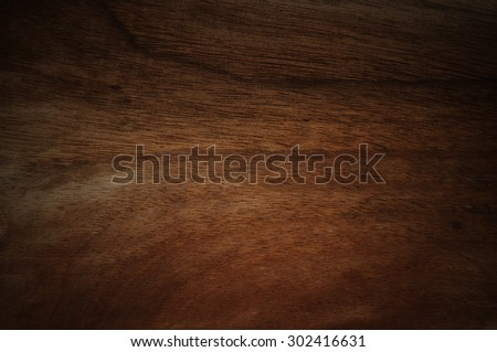 Dark walnut wood background faded - stock photo