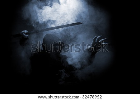 dark warrior in the smoke - stock photo
