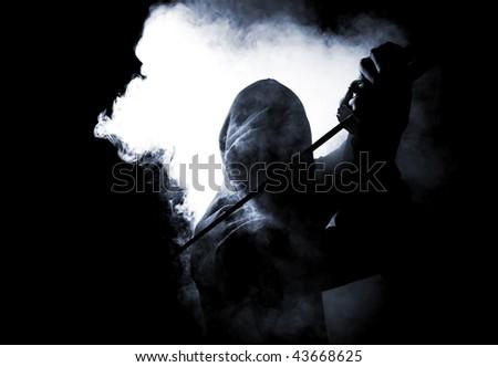 dark warrior in the smoke - stock photo