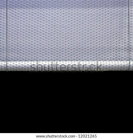 Dark window sun blind in roll made from rattan - stock photo