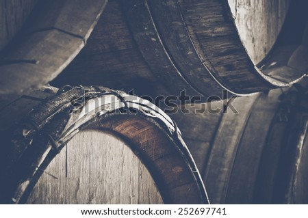 Dark Wine Barrels to store wine with vintage Instagram style film filter - stock photo