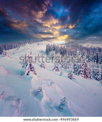 Dark winter scene in the mountains. Dramatic sunset in the Carpathians, ukraine, Europe. Artistic style post processed photo.