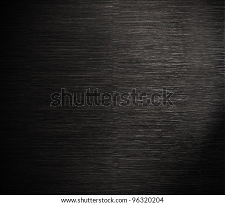 Dark wood texture, dramatic light and vignette - stock photo
